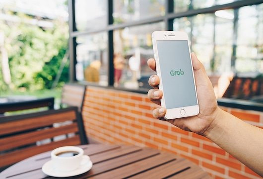 Grab in advanced talks to raise $300-500 mn for its financial services unit