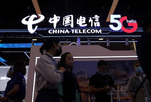 Shares in China Telecom, blacklisted by US, surge on Shanghai debut